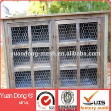 Wooden chicken coop use galvanized chicken wire netting