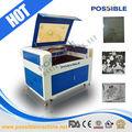 parte inferior precio venta caliente posible 1290 co2 de grabado láser de corte de la máquina se utiliza para marco de fotos de marcado