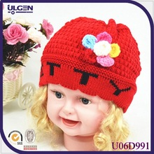 knitted winter children hat with flowers