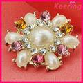 Venta al por mayor elegante diseño de botón a presión coninsignia de la perla para vestido de novia wbk-1308