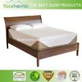 colchón de hotel estándar y cama