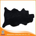 Dark black sheep wool and sheepskin material