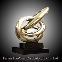 Abstract Gold Polished Metal Sculpture