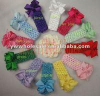 1.5crochet headbands with cliped ribbon bows.