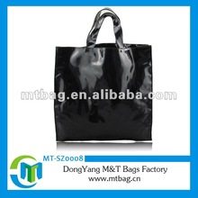 Bright black nylon tote bag with pu leather handle