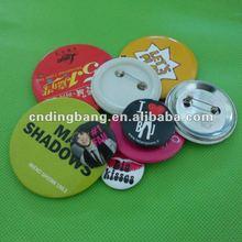 Tin round badge