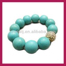 Fancy turquoise bead and rhinestone shamballa bead stretched bracelet