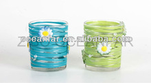 clear glass candle holder with rinband and flowers assortments
