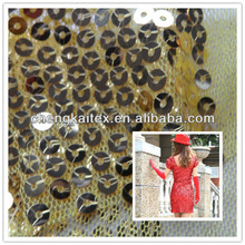 fabric with small gold holegram for performance
