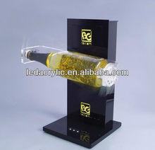 LED acrylic illuminated rotating bottle holder in wholesale