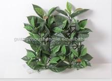 Artificial yulan magnolia tree leaves grass