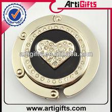 Cheap metal bag hanger heart handbag hook wholesale