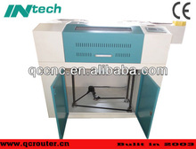 precision cheap laser wood engraving and cutting sliding table saw machine QC6040 with the lowest price