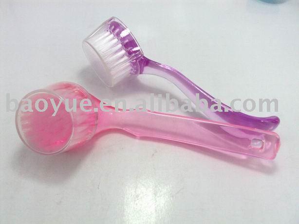 Soft pink facial brush