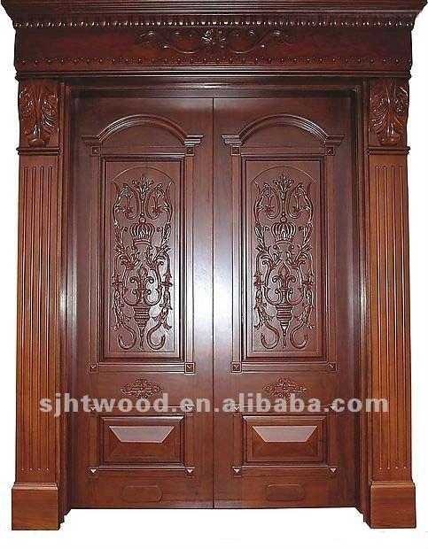 Puerta de entrada principal talladas a mano de madera for Puertas entrada madera maciza precios