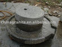 antique granite millstone