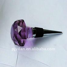 purple coloured decorative crystal wine stopper