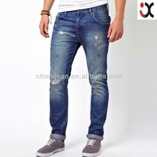 2015 de corea del estilo de la moda los pantalones vaqueros de mezclilla para hombres arrancado de mezclilla pantalones vaqueros jxq117