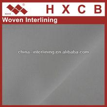 Térmica Bonded 100 poliéster sarja dupla Dot tecido Interlining alfaiataria materiais tecido fino