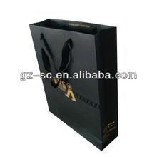 Black and gold foiled silk drawstring bag