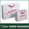 White kraft paper shopping bag with single color logo and red handle rope