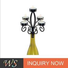 Romantic novelty design fashion black metal wine bottle candelabra/best seller wedding candlestick/ economic candle holder