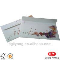 Ivory Paper Envelope with Gold Foil Logo