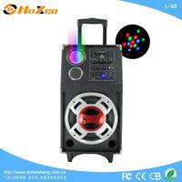 hi-end portable speaker with beautiful laser light/USB port/SD/FM/EQ/wireless MIC/remote control/guitar input