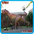 El parque temático de atracciones dinosaurio- t-rex