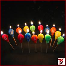 balloom shaped candles happy birthday in Spanish