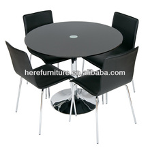 black color dining table with bent wood chair