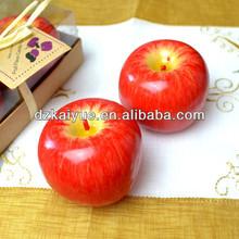 Christmas using decorative fruit candle