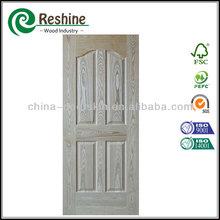 Internal molded veneer wood grain door skin
