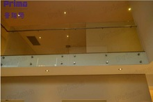 firm frameless glass handrail for terrace with steel spigots and simple designs