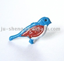 metal colored bird shaped brad for scrapbooking