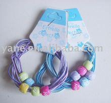 elastic band with metal barbs, hair holder, hair tie holder