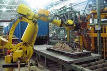 Robotic sand core handling system