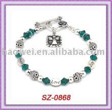 SZ-0868 Promotion evil eyes & skull bracelets with alloy & acrylic charm