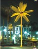 yellow LED lighted palm tree
