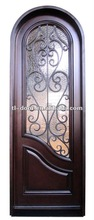 Wrought iron and wood entry dor