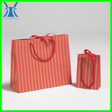 Yiwu 2014 top popular new design elegant decoration manufacturing glossy red paper bag