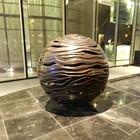 Large cast copper ball sculpture