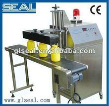Aluminum foil induction plastic bottle cap sealing machine