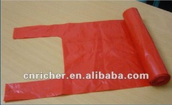Red Plastic shopping/supermarket t-shirt bags on roll
