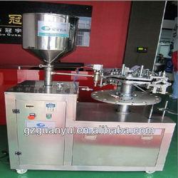 Semi-automatic filling and sealing machine