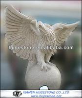 Lifelike eagle sculptures, Eagle and a ball stone statue