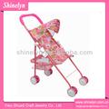 Sl-044 paraguas mini juguete de color rosa precioso bebé de tela stoller muñeca cochecito de niño y para los niños paraguas mini juguete de mejor venta de juguetes de ruedas