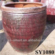Rustic red,Antique ceramic urn