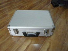 small aluminum case with striped panel
