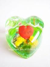 heart shape water globe inside 3d figurine